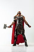 Man in cosplaying Thor isolated on white studio background