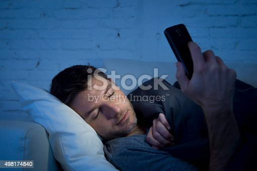 istock man in couch falling asleep using mobile phone 498174840