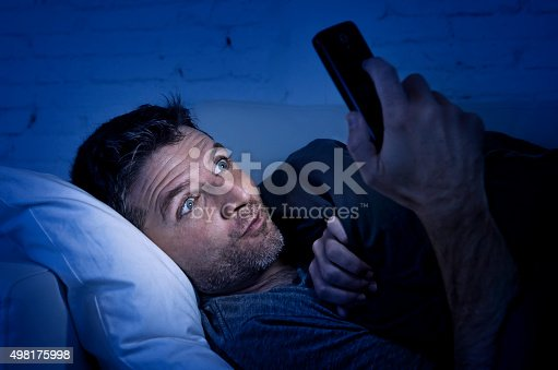 istock man in couch using mobile phone watching online porn 498175998