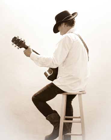Magnificent Man In Cowboy Hat On Stool Playing Guitar Stock Photo Bralicious Painted Fabric Chair Ideas Braliciousco
