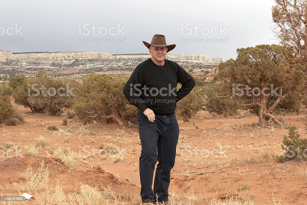 25152b025ae75 ... reduced man in cowboy hat red rock formation arizona royalty free stock  photo 74672 0f928