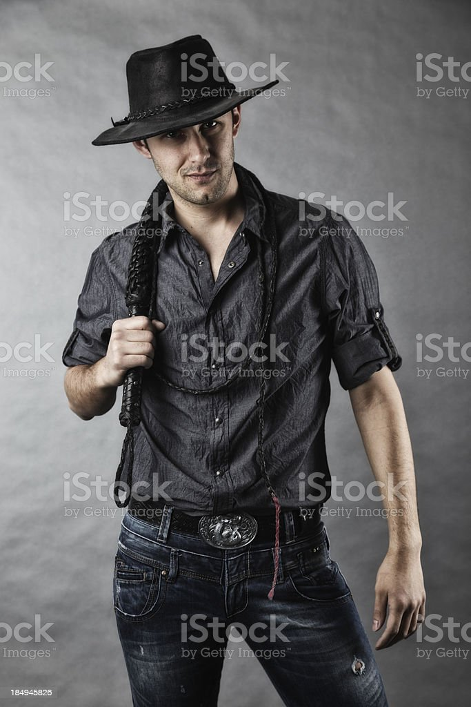 Man in Cowboy Hat With Bullwhip royalty-free stock photo
