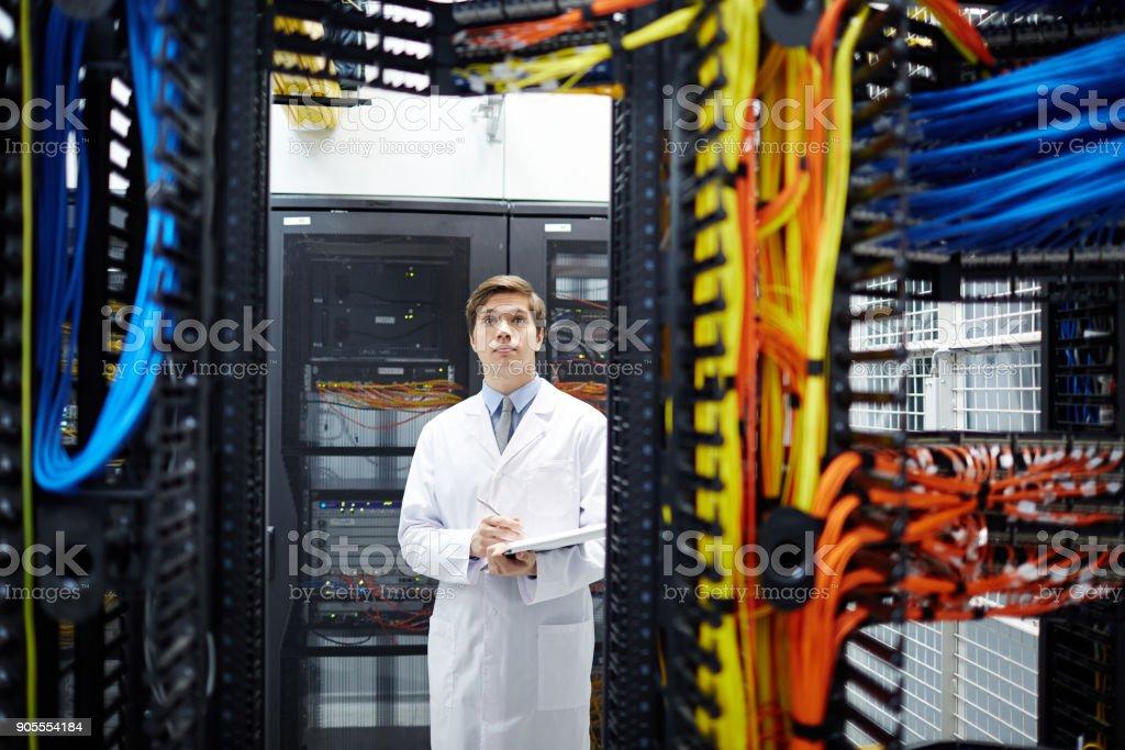 Man in data center stock photo