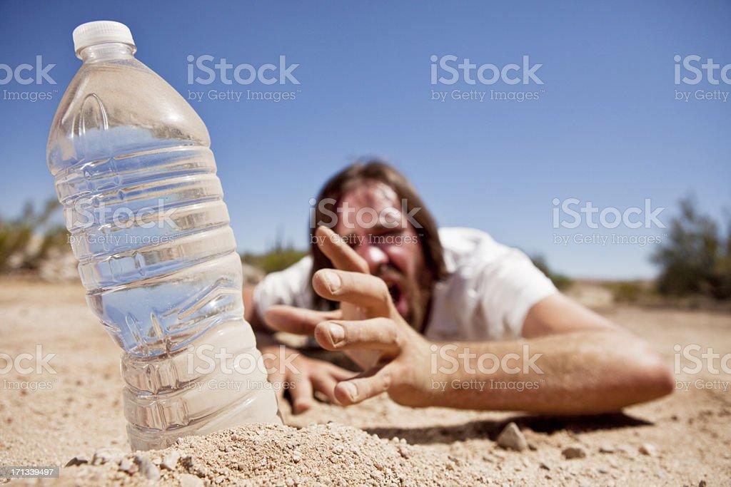 Man in Desert Reaching for Water royalty-free stock photo