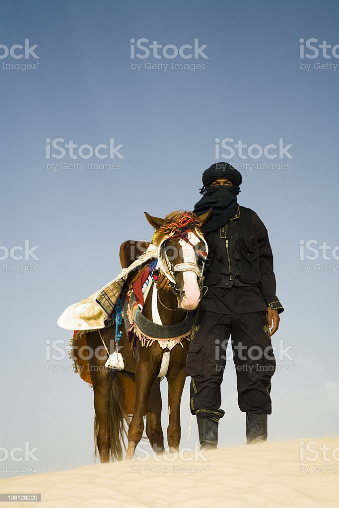 Man in Desert with Horse stock photo