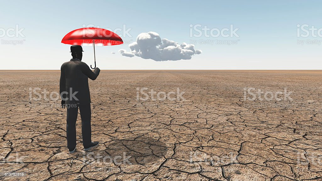 Man in desert with umbrella and single cloud stock photo