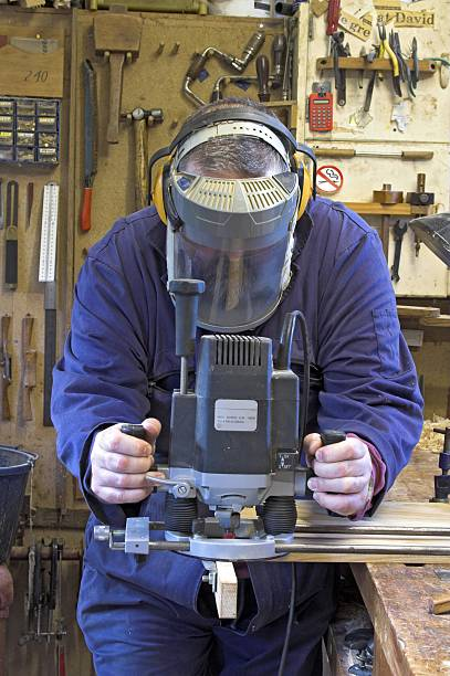 man in dust mask routing - helmet visor stock photos and pictures