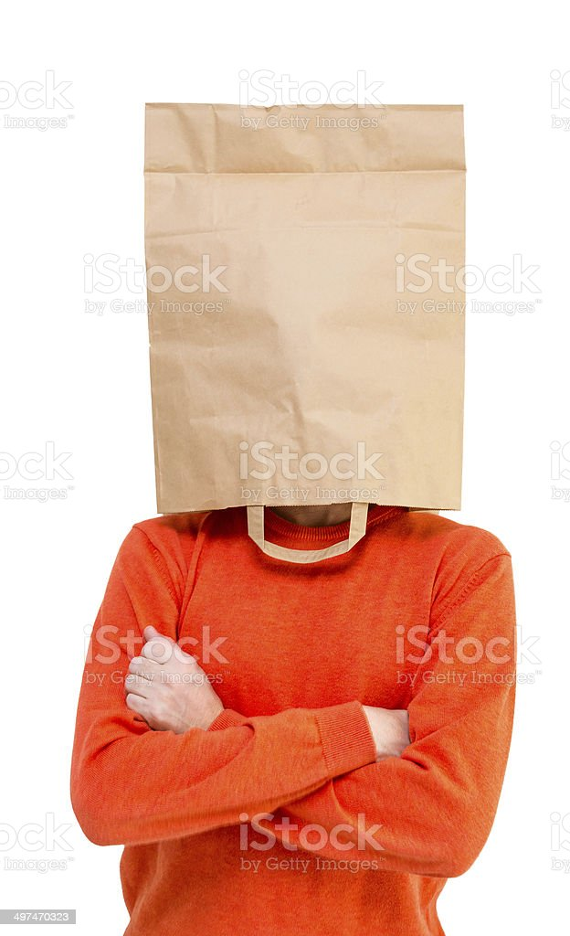 Man in ecological paper bag on head stock photo