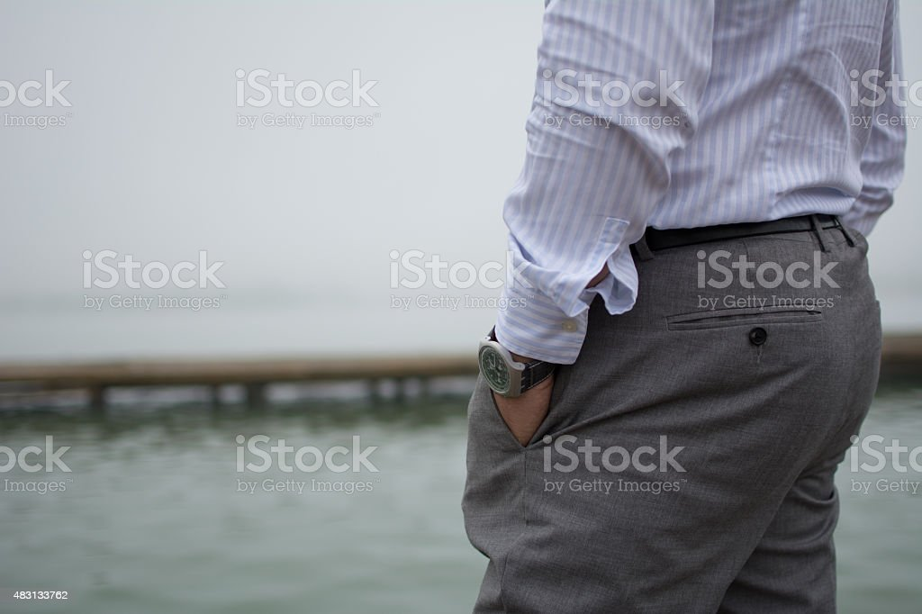 Man in elegant shirt and trousers stock photo