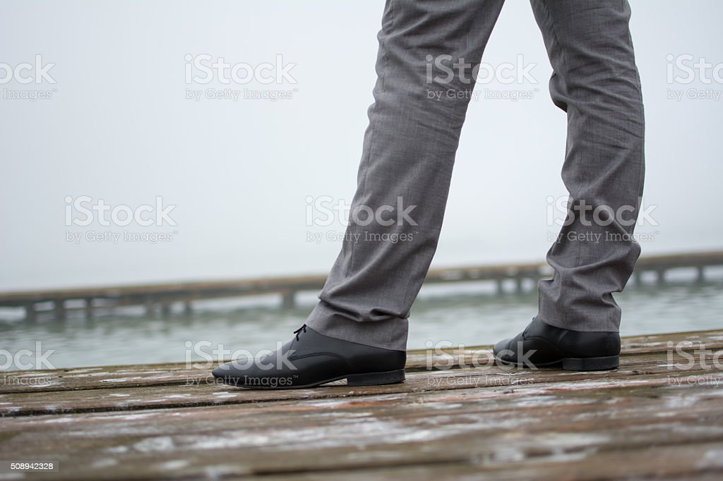 Man in elegant shoes and trousers stock photo