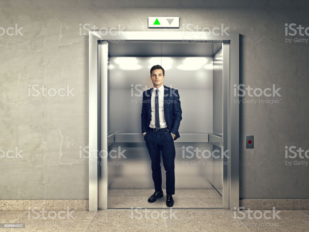 man in elevator stock photo
