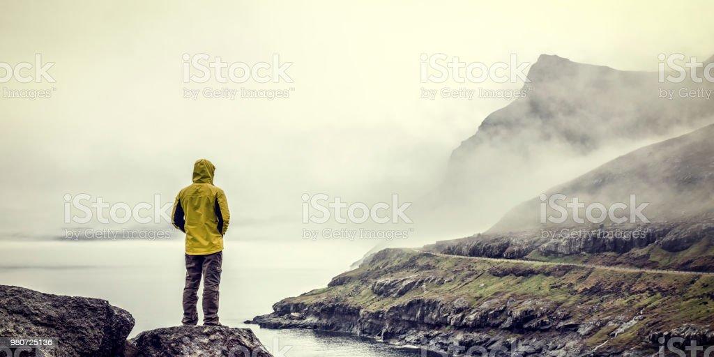man in faroe islands stock photo