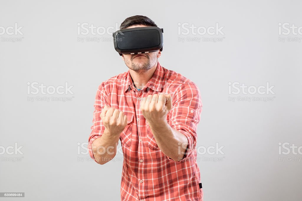 Man in fighter stand with virtual reality glasses royalty-free stock photo
