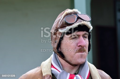 Stowe Maries Airfield England, United Kingdom - May 14, 2014: Portrait of Man in World War I flying hat  recreating uniform of Royal Air Force in world war I at flying event