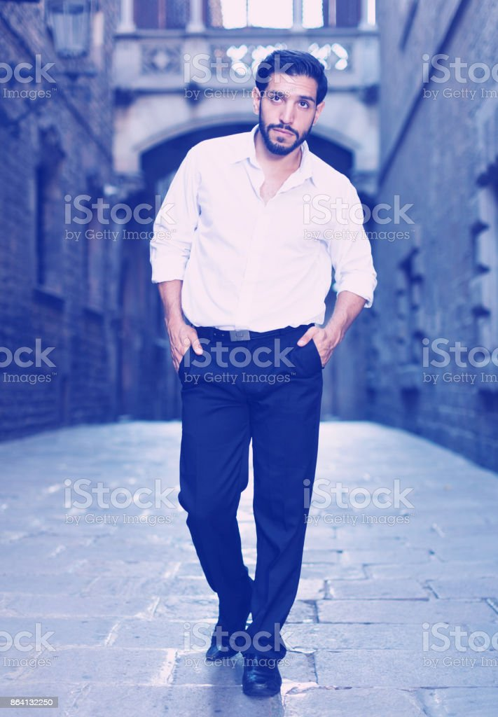 Man in formalwear walking along street royalty-free stock photo