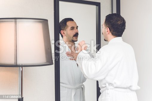 istock Man in front of a mirror 1141388903