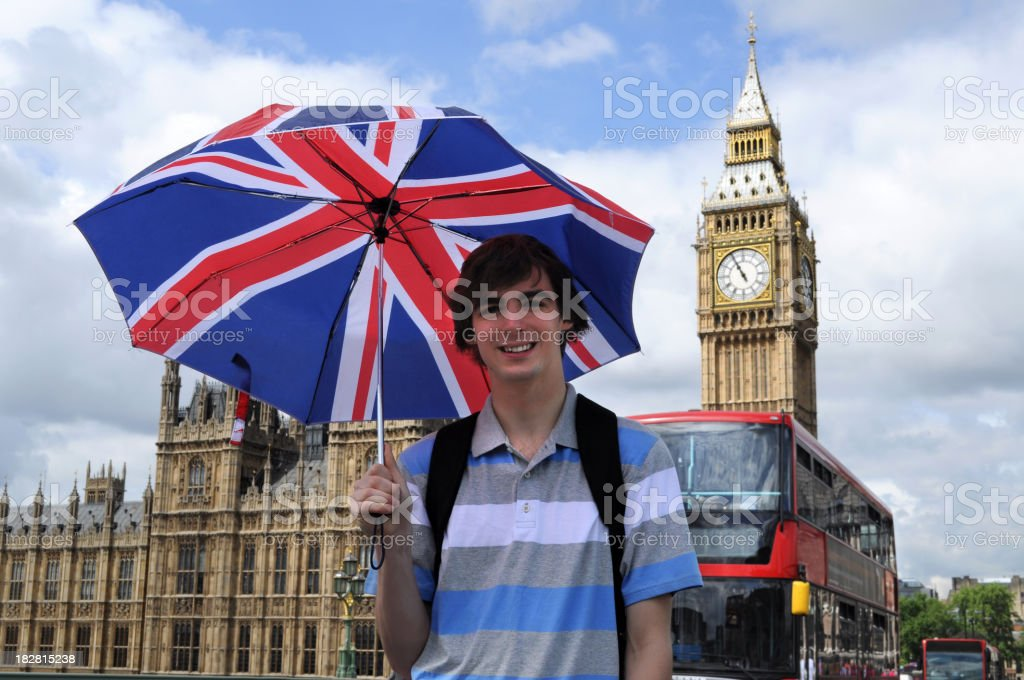 Man in front of Big Ben with a British flag umbrella royalty-free stock photo