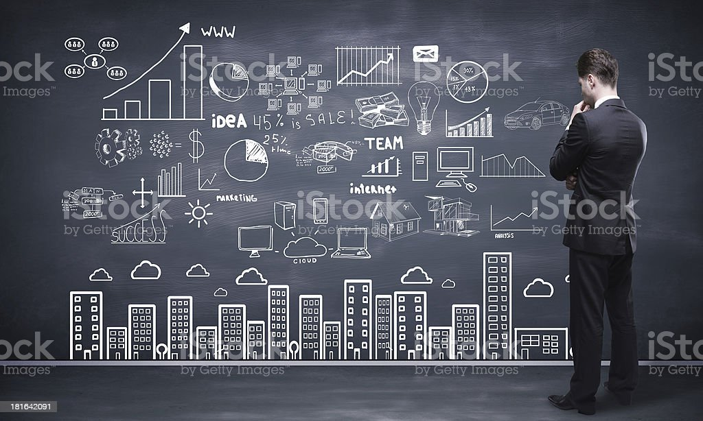 Man in front of chalkboard with global concepts stock photo