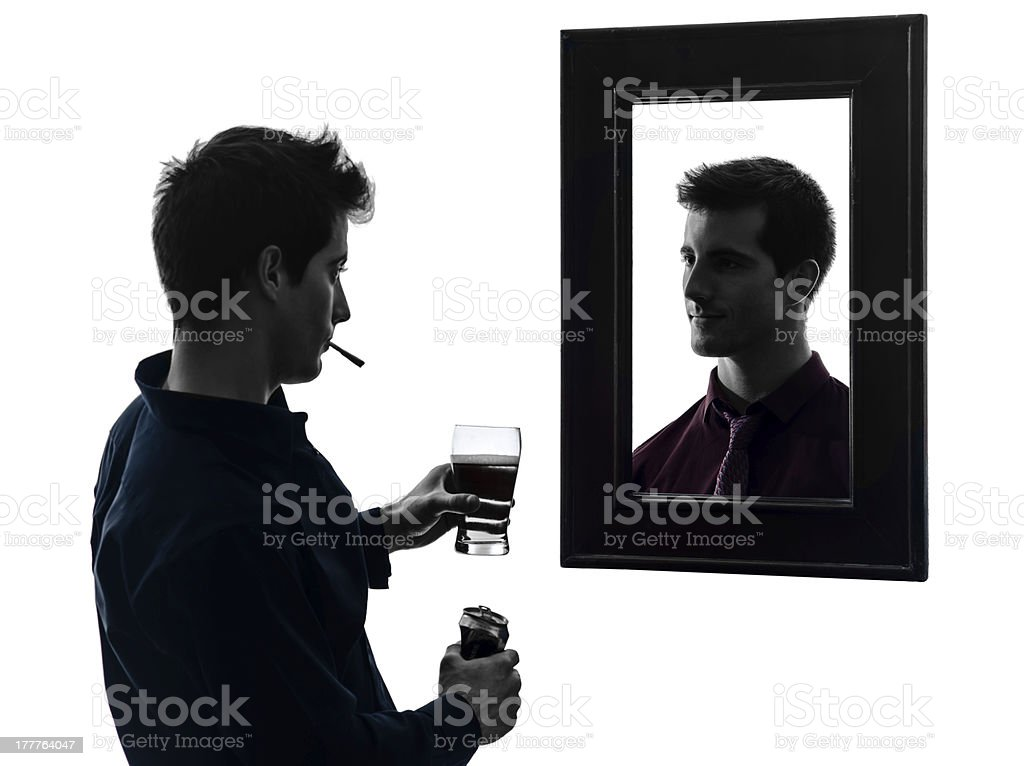 man in front of his mirror silhouette royalty-free stock photo