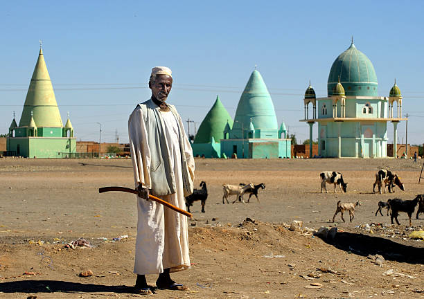 Man in front of muslim mausoleums, Sudan stock photo