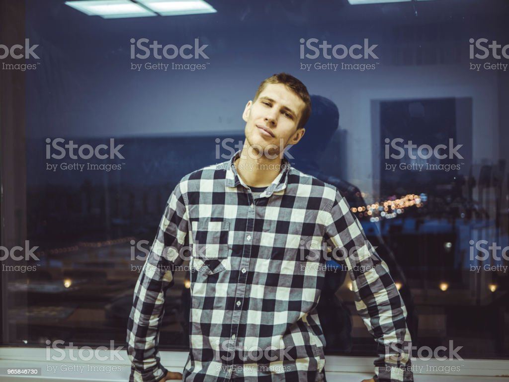 man in front of night city streets in the window - Royalty-free Adult Stock Photo