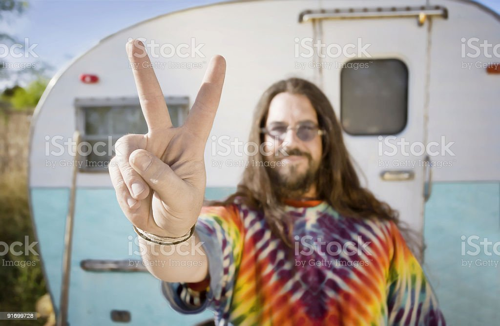 Man in Front of Trailer Making a Peace Sign stock photo