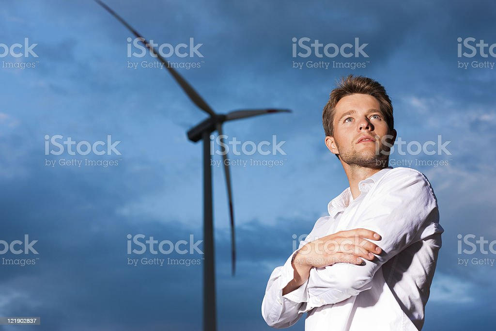 Man in front of windmill and sky royalty-free stock photo