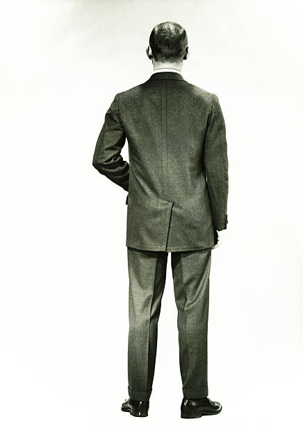 man in full suit standing in studio, (rear view), (b&w) - 1940s style stock pictures, royalty-free photos & images