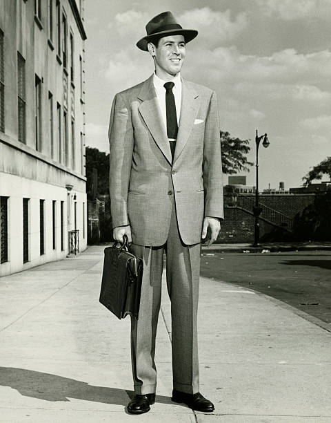 man in full suit standing on sidewalk, (b&w), (portrait) - 1940s style stock photos and pictures