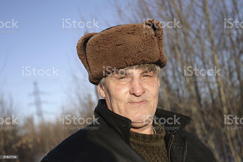Man in fur-cap royalty-free stock photo