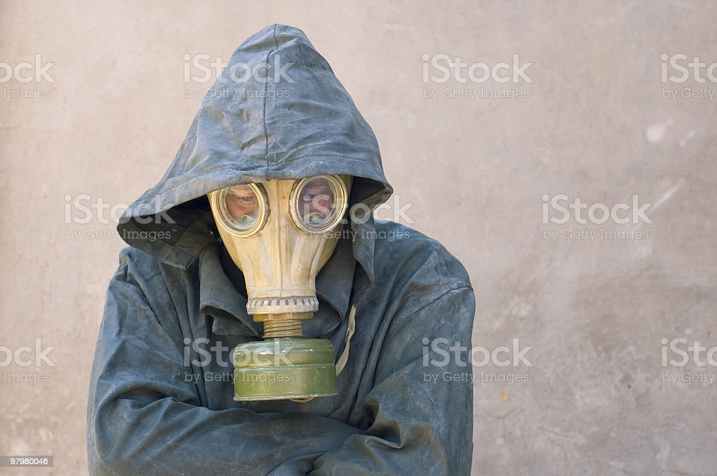 man in gas mask and groundsheet royalty-free stock photo