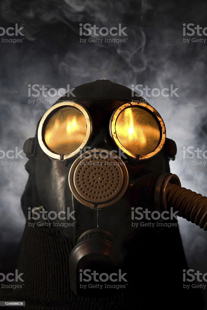Man in gas mask over smoky background royalty-free stock photo