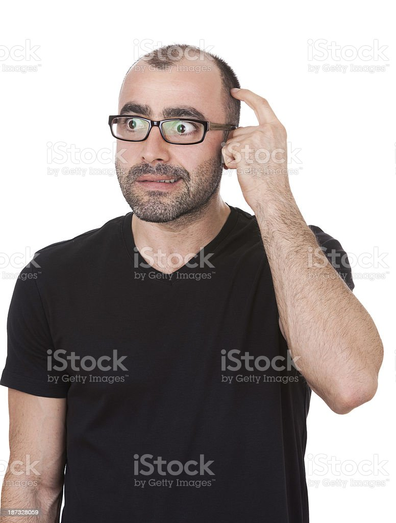 Man in Glasses Thinks and Scratches Head White Background royalty-free stock photo