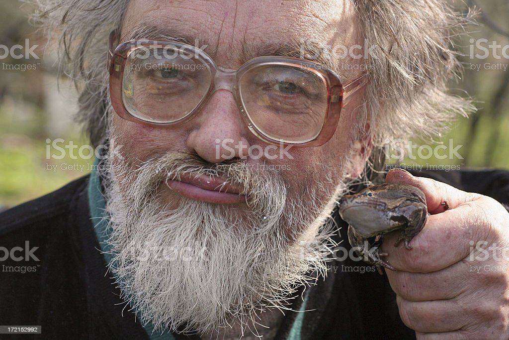 man in glasses with frog royalty-free stock photo