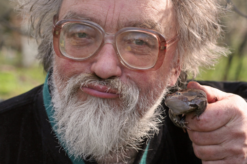 The man in glasses with a frog