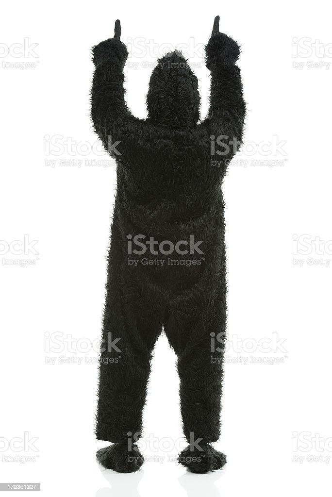 Man in gorilla costume and pointing upwards royalty-free stock photo