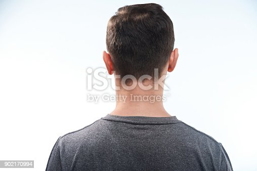 956902000 istock photo Man in gray shirt back view 902170994