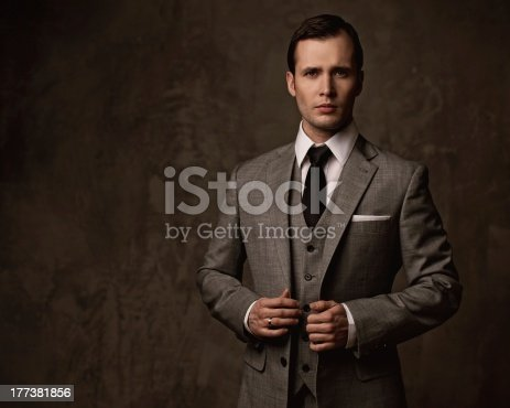 Man in grey suit.