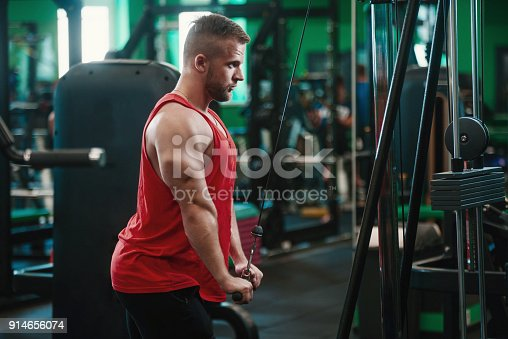 istock Man in gym doing Exercise for triceps in the gym 914656074