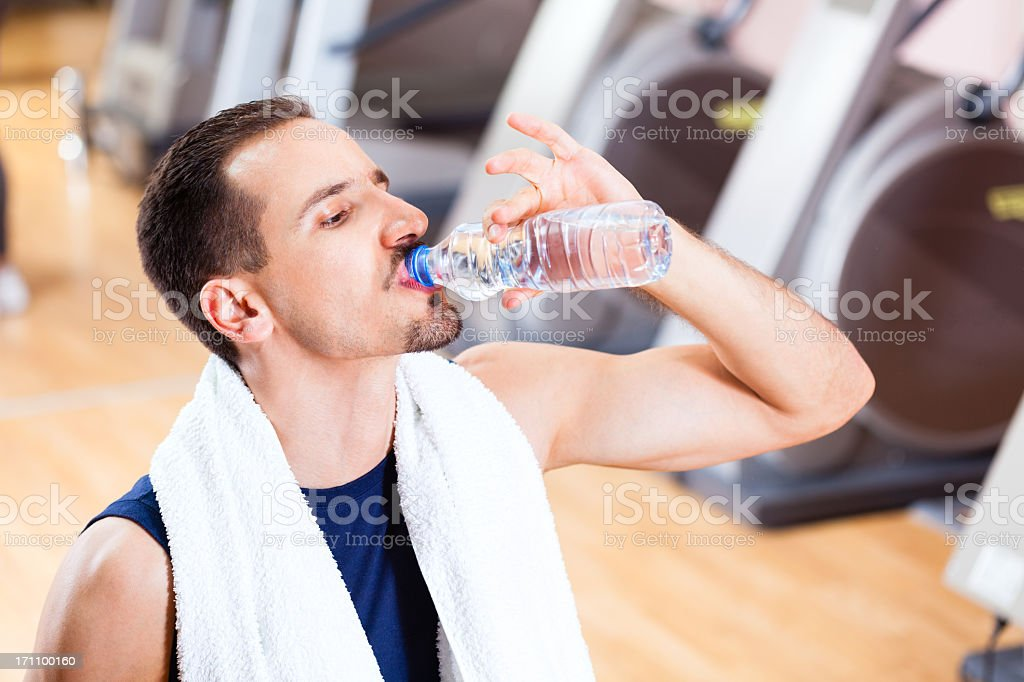 Man in gym drinking water stock photo istock man in gym drinking water royalty free stock photo sciox Gallery