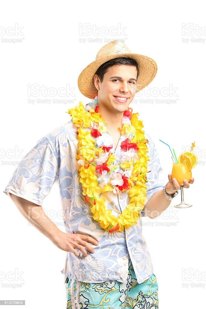 Man in Hawaiian clothes holding a cocktail stock photo