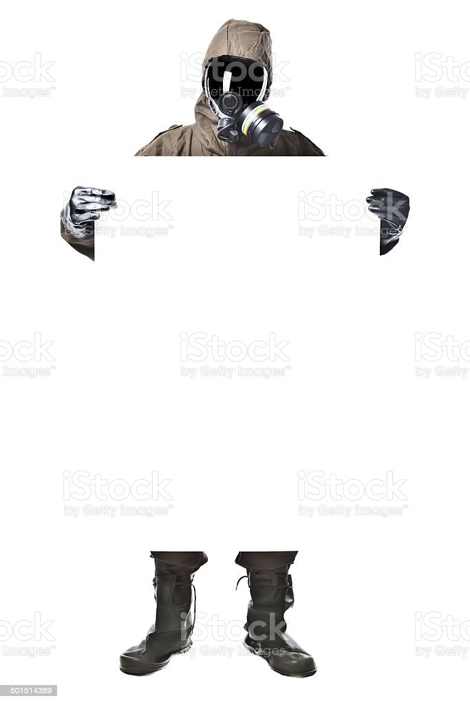 Man in Hazard Suit holding a billboard stock photo