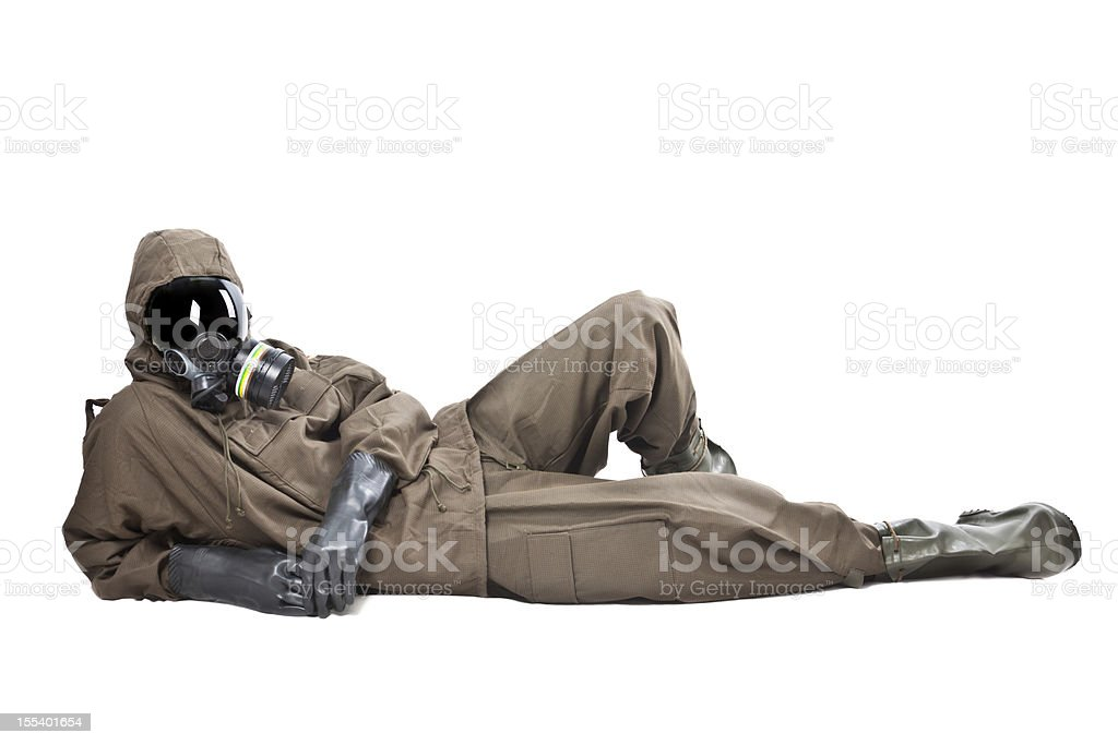 Man in Hazard Suit layng on the ground stock photo