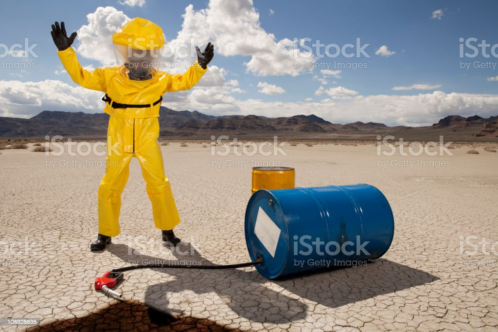 Man in hazmat suit upset over an oil spill stock photo