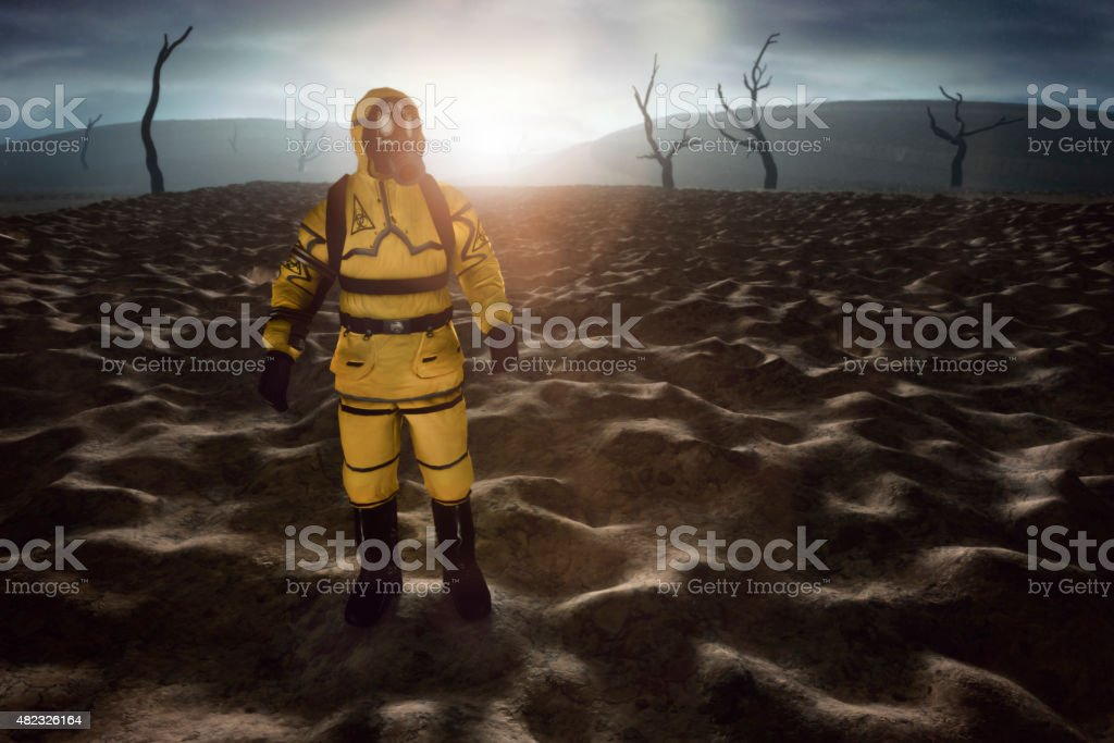 Man in hazmat suit walking in destroyed environment royalty-free stock photo