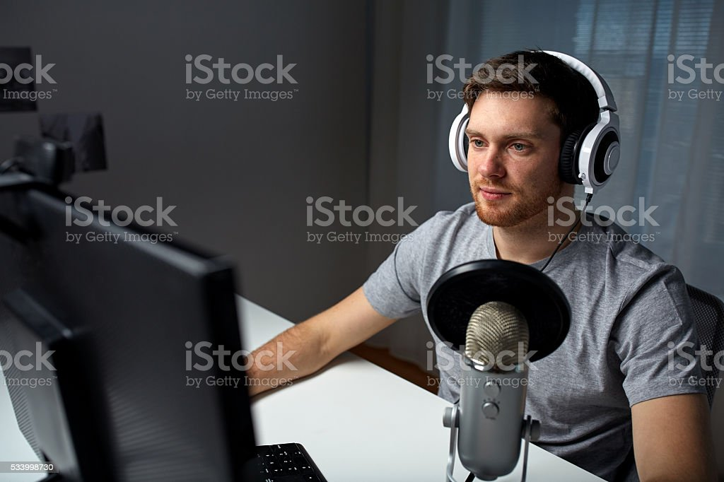 man in headset playing computer video game at home stock photo