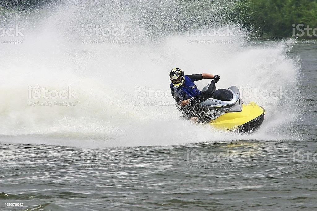 Man in helmet performing jet ski maneuvers royalty-free stock photo