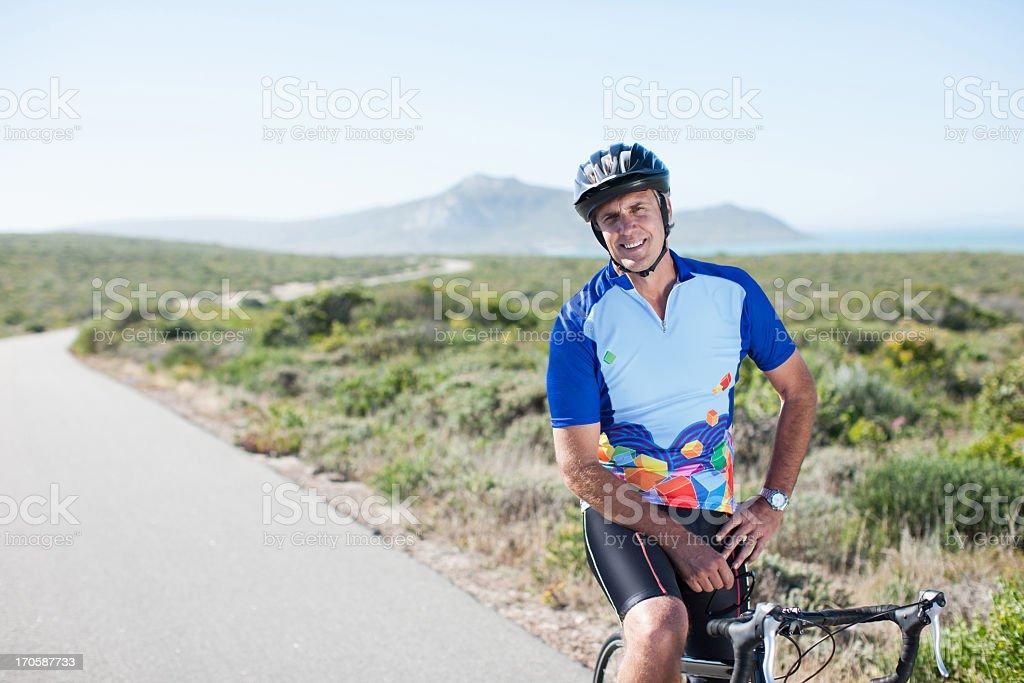 Man in helmet sitting on bicycle stock photo