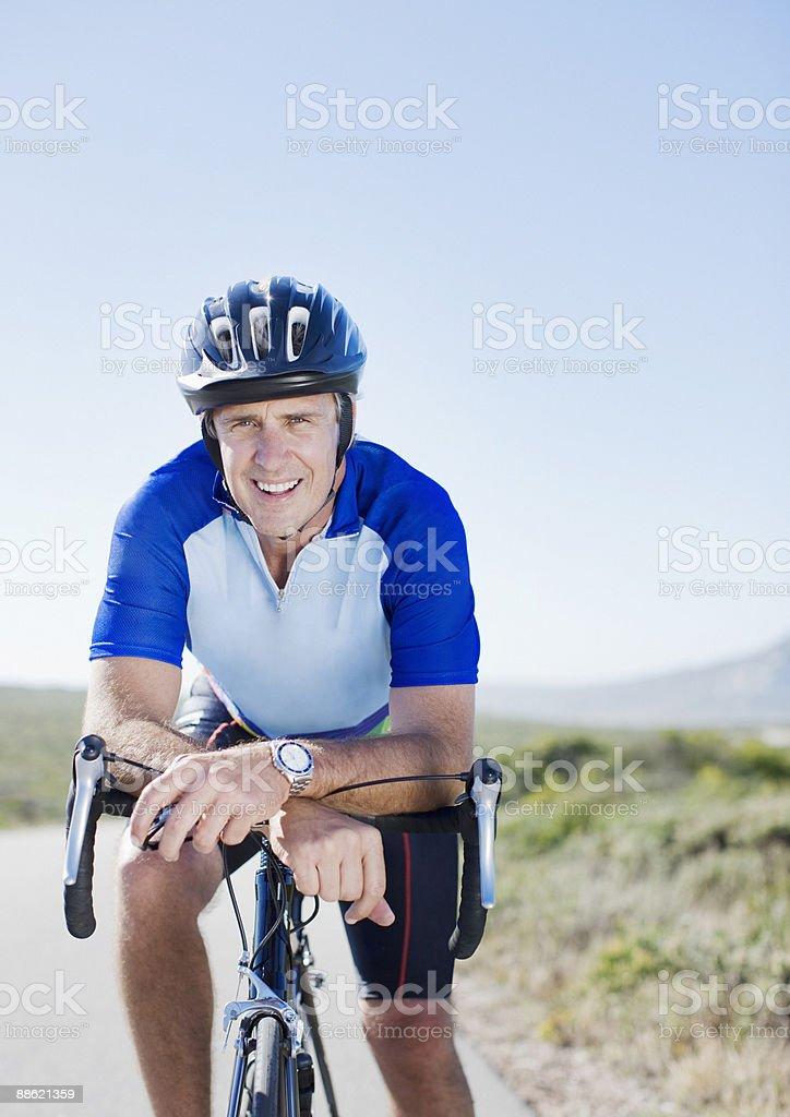 Man in helmet sitting on bicycle royalty-free stock photo