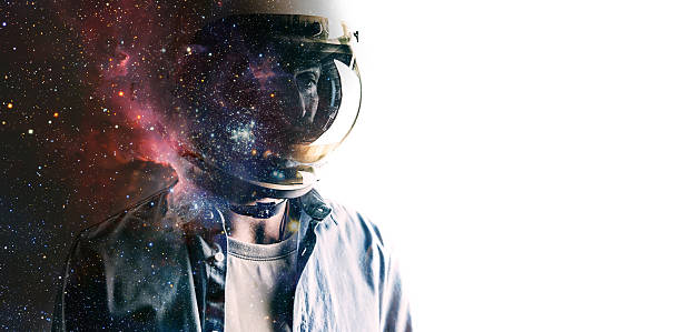 Man in helmet with starry sky on shield stock photo